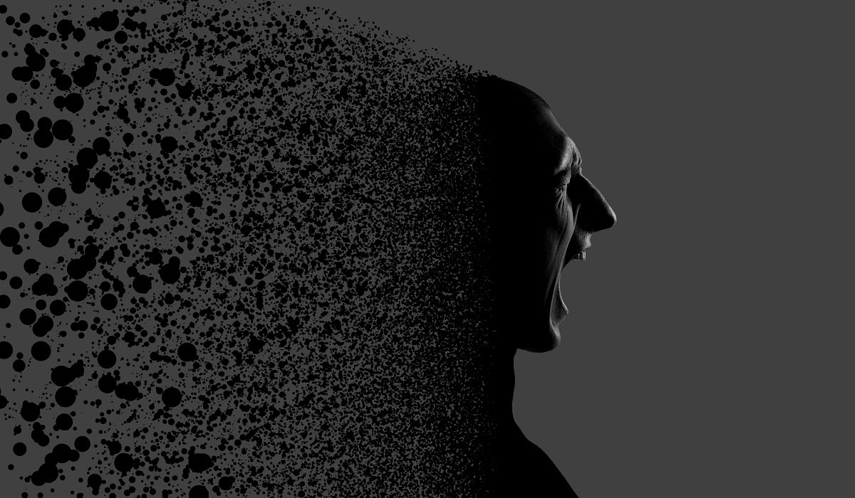 What Can A Husband Do To Save His Marriage? He must die to self (a black and gray image of a husbands back of his head breaking apart in particles)