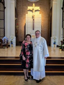 successful marriage deacon brad anderson part 2 - Deacon Brad Anderson and his wife Kathy posing in front of a gigantic crucifix!