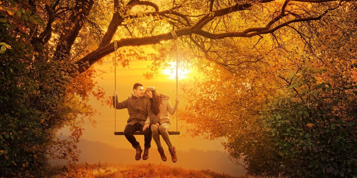 Romantic couple swing in the autumn park