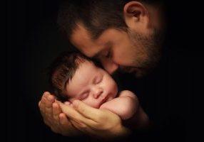 The true measure of a man are you are holy lover? Upholding the principles (a father holding his newborn baby up against his chest hands and face)